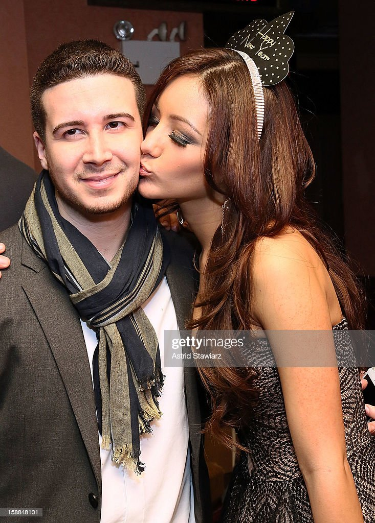 <a gi-track='captionPersonalityLinkClicked' href=/galleries/search?phrase=Vinny+Guadagnino&family=editorial&specificpeople=6693900 ng-click='$event.stopPropagation()'>Vinny Guadagnino</a> poses for photos with <a gi-track='captionPersonalityLinkClicked' href=/galleries/search?phrase=Melanie+Iglesias&family=editorial&specificpeople=7417582 ng-click='$event.stopPropagation()'>Melanie Iglesias</a> during Joonbug's New Year's Eve 2013 Celebration With <a gi-track='captionPersonalityLinkClicked' href=/galleries/search?phrase=Vinny+Guadagnino&family=editorial&specificpeople=6693900 ng-click='$event.stopPropagation()'>Vinny Guadagnino</a> at AMC 34th Street on December 31, 2012 in New York City.