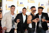 Vinny Guadagnino Ronnie 'Fist Pump Brah' Magro Mike 'The Situation' Sorrentino and Pauly Del Vecchio arrive at the 2010 MTV Movie Awards held at the...