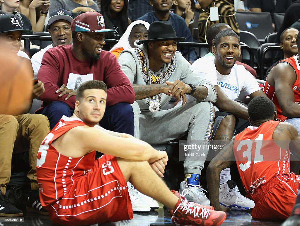 Vinny Guadagnino, Tim Hardaway Jr., Carmelo Anthony and Kyrie Irving attend the 2014 Summer Classic Charity Basketball Game at Barclays Center on August 21, 2014 in New York City.