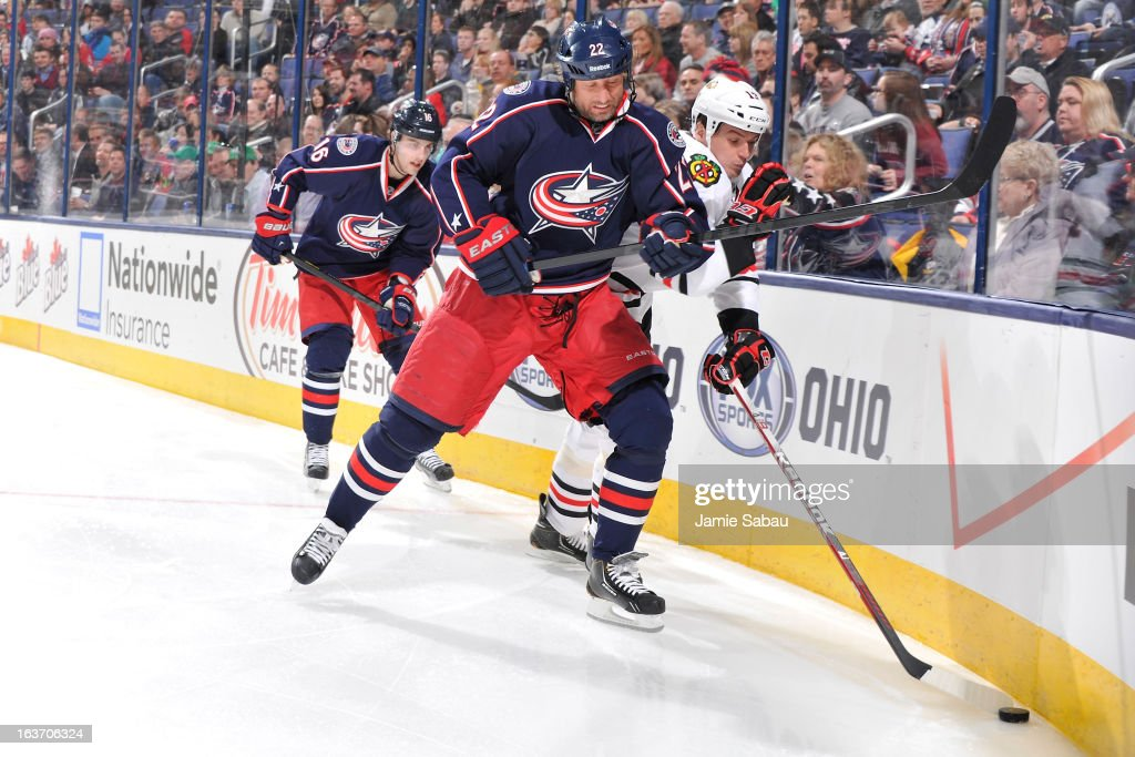 Vinny Prospal #22 of the Columbus Blue Jackets attempts to knock <a gi-track='captionPersonalityLinkClicked' href=/galleries/search?phrase=Sheldon+Brookbank&family=editorial&specificpeople=586095 ng-click='$event.stopPropagation()'>Sheldon Brookbank</a> #17 of the Chicago Blackhawks off the puck during the third period on March 14, 2013 at Nationwide Arena in Columbus, Ohio. Chicago defeated Columbus 2-1 in a shootout.
