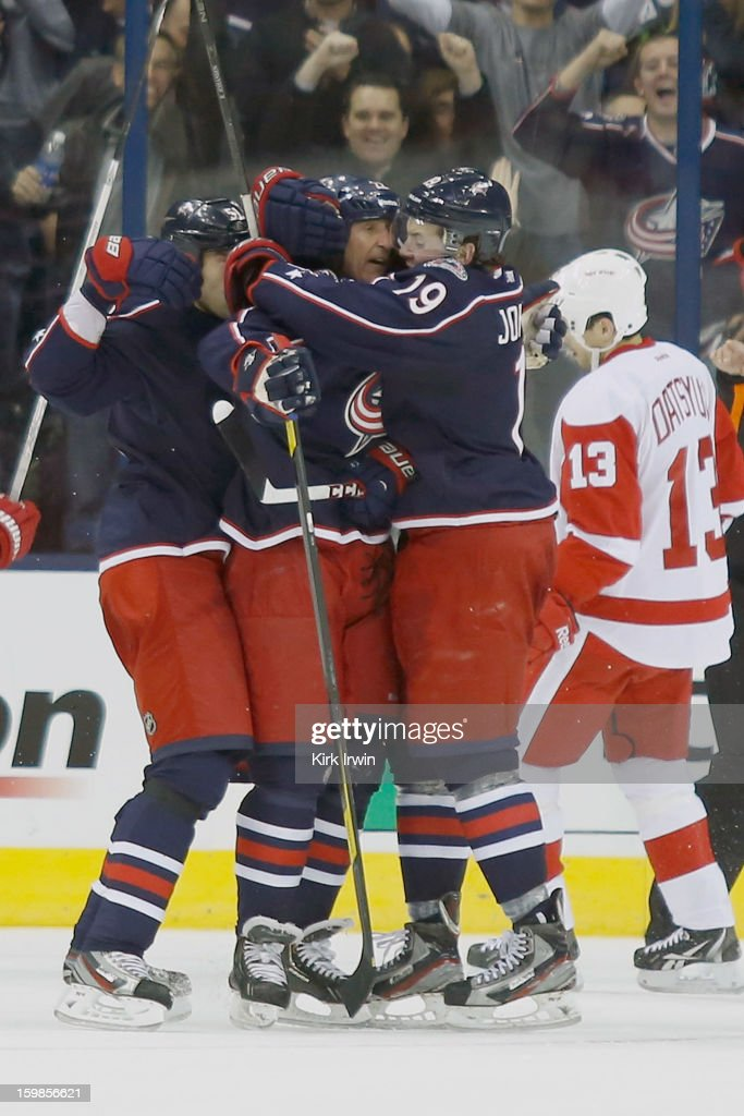 Vinny Prospal #22 of the Columbus Blue Jackets is congratulated by Fedor Tyutin #51 of the Columbus Blue Jackets and Ryan Johansen #19 of the Columbus Blue Jackets after scoring a goal against the Detroit Red Wings during the third period on January 21, 2013 at Nationwide Arena in Columbus, Ohio. Detroit defeated Columbus 4-3 in a shootout.