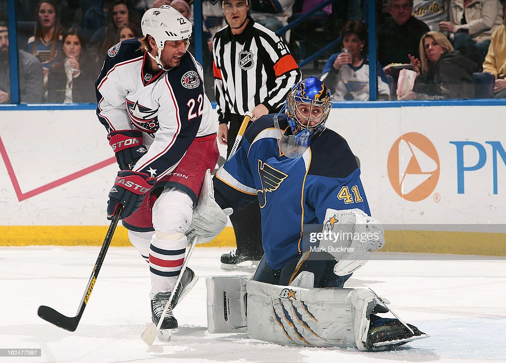 Vinny Prospal #22 of the Columbus Blue Jackets looks for the puck as goalie <a gi-track='captionPersonalityLinkClicked' href=/galleries/search?phrase=Jaroslav+Halak&family=editorial&specificpeople=2285591 ng-click='$event.stopPropagation()'>Jaroslav Halak</a> #41 of the St. Louis Blues defends in an NHL game on February 23, 2013 at Scottrade Center in St. Louis, Missouri.