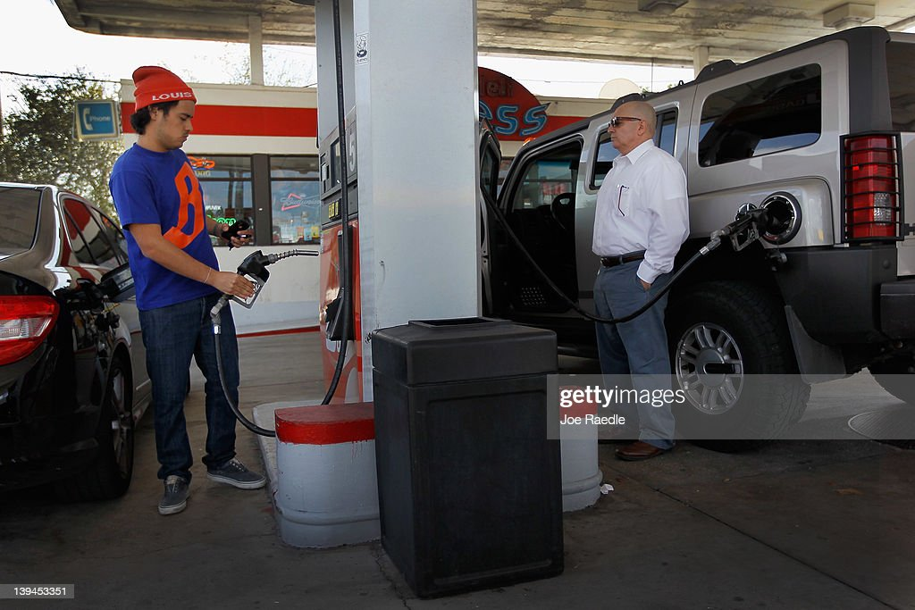 Vinny Spadei and Hugo Hernandez (L-R) fill their vehicles up with gas in a county where some grades of gasoline have already surpassed the $4 mark on February 21, 2012 in Miami, Florida. Fears of $5 per gallon gasoline are being heard as summer approaches and some feel that would hurt the economy just as an economic recovery appears to be getting traction.