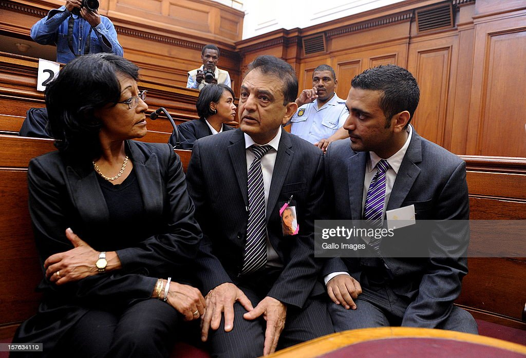 Vinod Hindocha, father of murdered Anni Dewani is supported by family members at the Cape Town High Cour at the Cape Town High Court on December 5, 2012 in Cape Town, South Africa. Xolile Mngeni was sentenced to life in prison for the murder of Anni Dewani