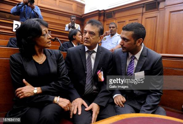 Vinod Hindocha father of murdered Anni Dewani is supported by family members at the Cape Town High Cour at the Cape Town High Court on December 5...
