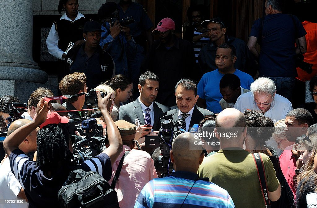 Vinod Hindocha, father of murdered Anni Dewani is surrounded by the press outside the Cape Town High Cour at the Cape Town High Court on December 5, 2012 in Cape Town, South Africa. Xolile Mngeni was sentenced to life in prison for the murder of Anni Dewani.
