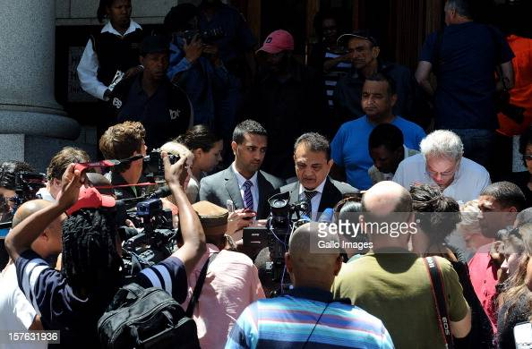 Vinod Hindocha father of murdered Anni Dewani is surrounded by the press outside the Cape Town High Cour at the Cape Town High Court on December 5...