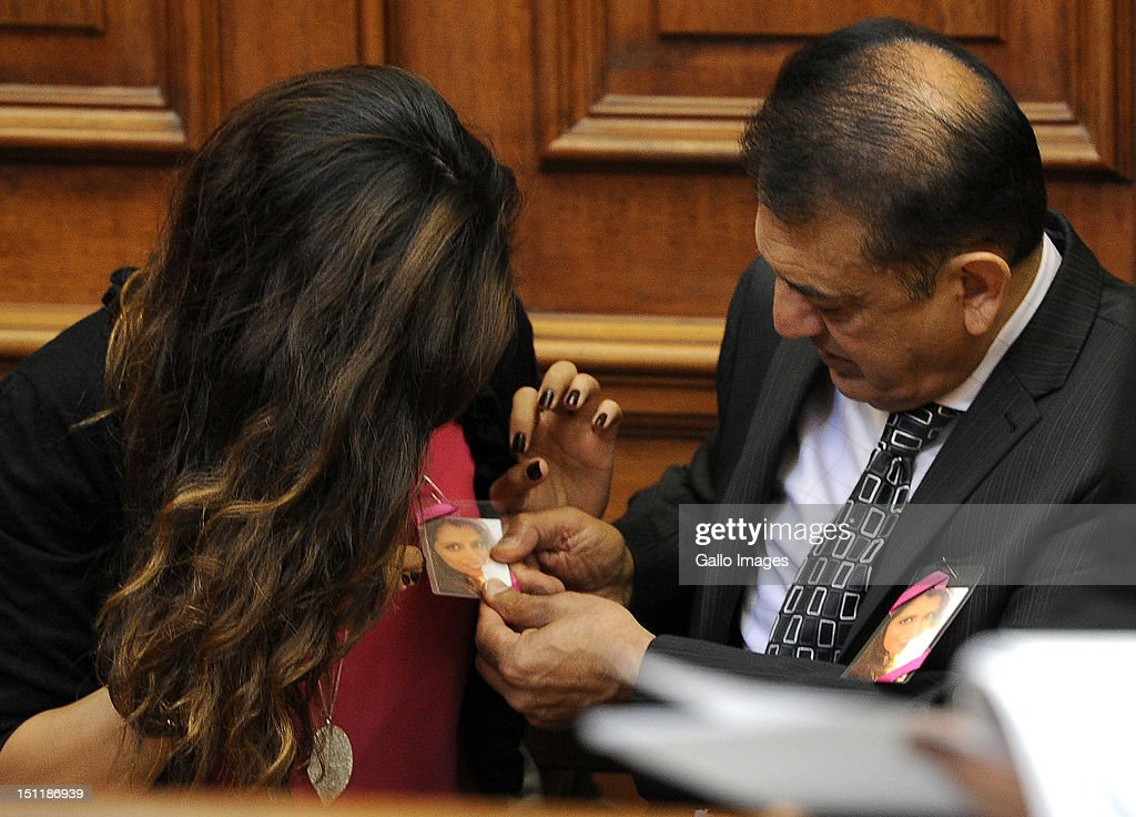 Vinod Hindocha, father of murdered Anni Dwani and Anni's cousin Nishma Hindocha appear at the Cape Town High Court, on September 3, 2012 in Cape Town, South Africa. They are attending the trial of Xolile Mngeni, who is accused of being involved in the murder of Anni. The deceased's husband Shrien Dewani remains in Britain fighting extradition as he faces accusations of allegedly plotting her murder.