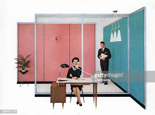 Vintage 1950s 'modern' business office with a boss watching as his secretary answers the telephone 1958 Screen print