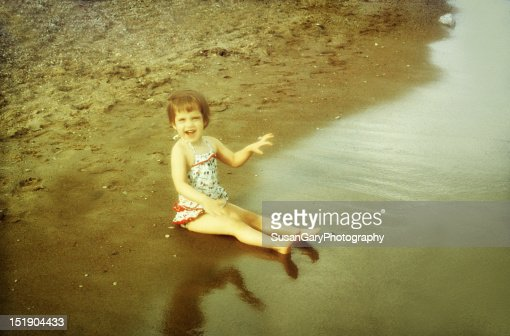 Vintage 1960's little girl on beach : Stock Photo
