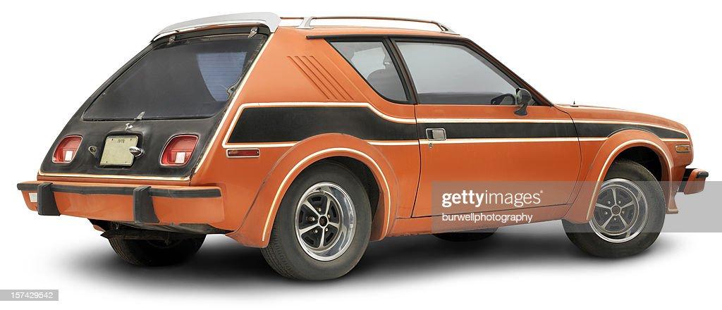 Vintage 1978 Orange Gremlin, isolated on white