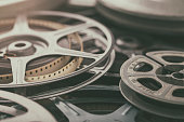 Vintage 8mm home movies on film reels with film leaders and spools.