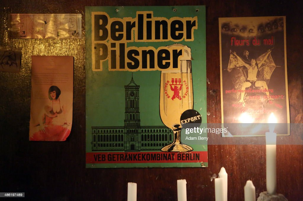 A vintage advertisement for Berliner Pilsner beer hangs at the Alt Berlin (Old Berlin) bar on April 22, 2014 in Berlin, Germany. The bar, which opened in 1893 and is known for its familial atmosphere, is claimed to be the oldest bar in the German capital, a city with few remaining pre-War drinking establishments in comparison to other major European cities. A petition has been launched to convince the bar's landlord to allow the business to stay open after its expected closure at the end of the month due to skyrocketing real estate prices in the city's popular and central Mitte neighborhood.