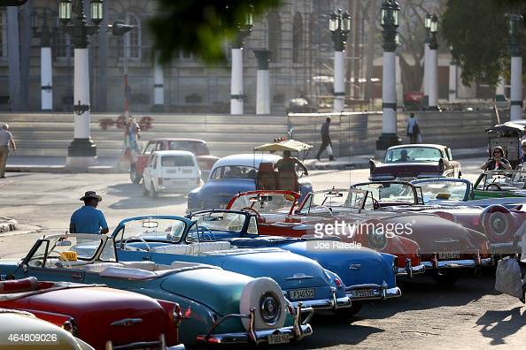 Vintage American automobiles are seen on the street as their owners wait for tourists wanting a ride a day after the second round of diplomatic talks...
