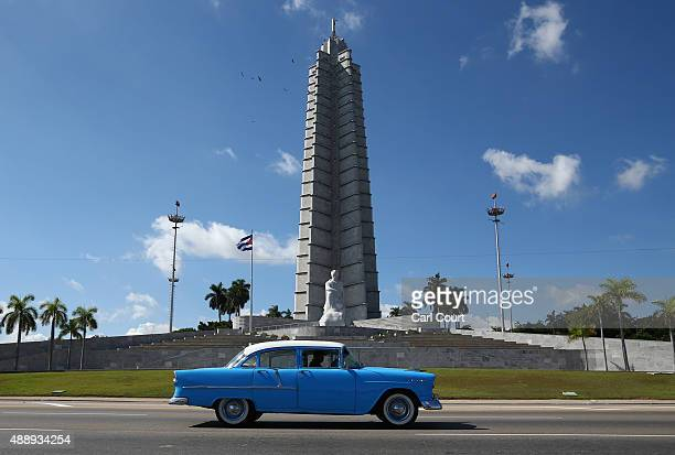 A vintage American car is driven past the Jose Marti Memorial in Revolution Square where Pope Francis will perform Mass during his visit to Havana on...