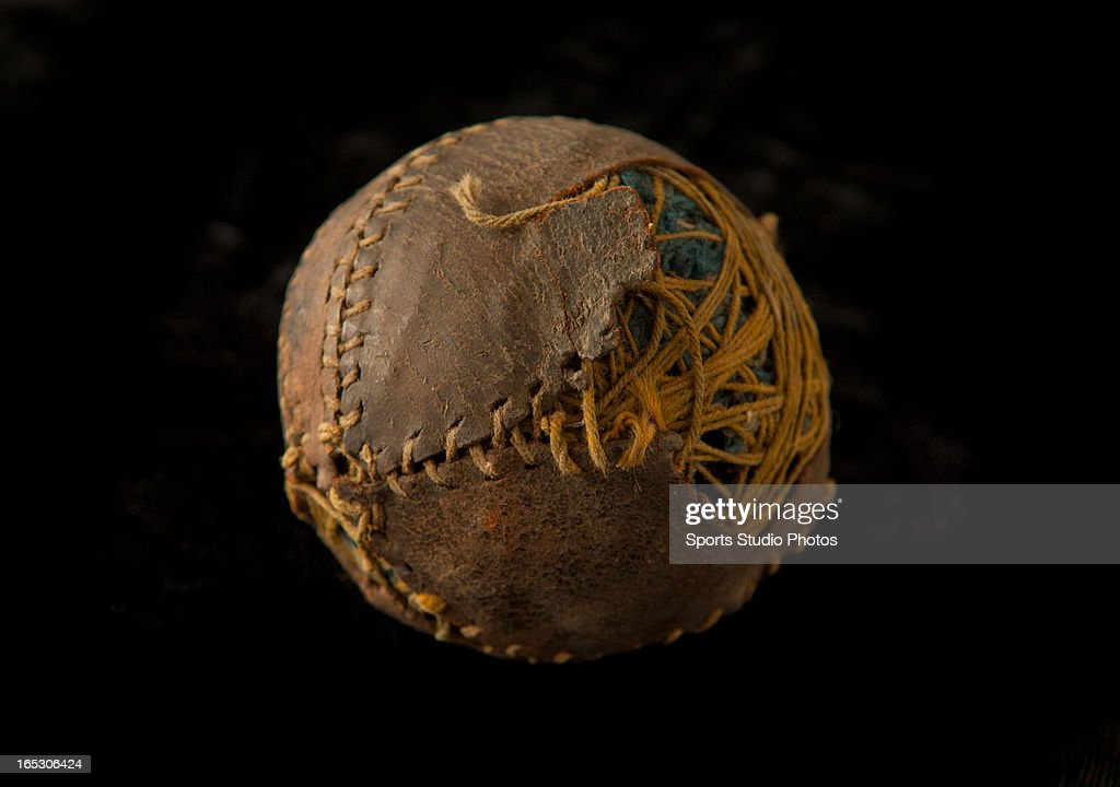 Vintage Antique Baseball . Early turn of the century lemon peel style baseball. Features leather exterior with broken seams.