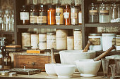 A collection of vintage turn of the 20th century chemicals and equipment used in medicine at the time.