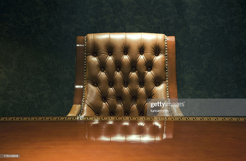 Vintage armchair and desk : Stock Photo