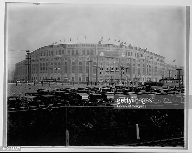 Vintage autos are parked next to Yankee Stadium around 1925