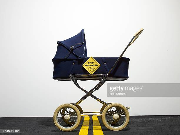 Vintage baby carriage with sign