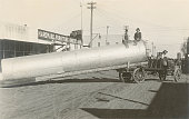 Photo of Men on Giant Pipe