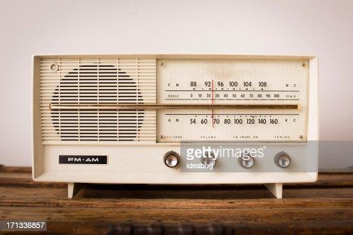 Vintage Beige Radio Sitting on Wood Table