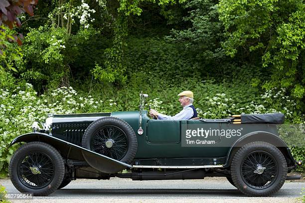 Vintage Bentley 45 litres car built in 1929 being driven on touring holiday along country lanes in The Cotswolds UK
