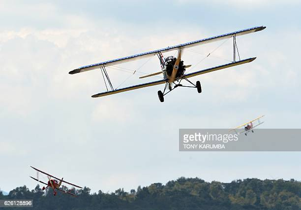 Vintage biplanes fly at a low altitude over the Nairobi National Park in Nairobi on November 27 2016 as part of of a crossAfrica rally of vintage...