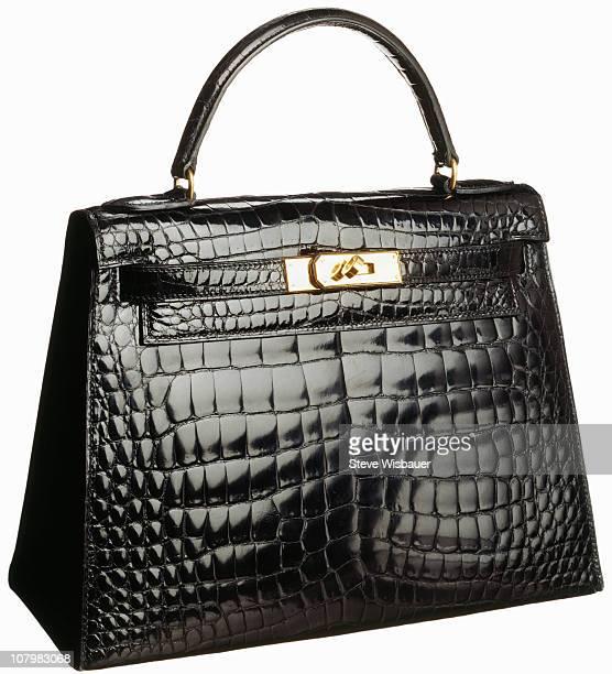 A vintage black crocodile handbag