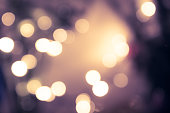 Blue toned bokeh with blurred sparkling christmas lighting in vintage style