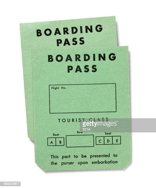 Vintage boarding passes on white -Tourist Class