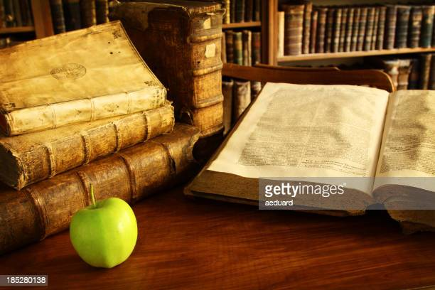 Vintage books in a library with an apple