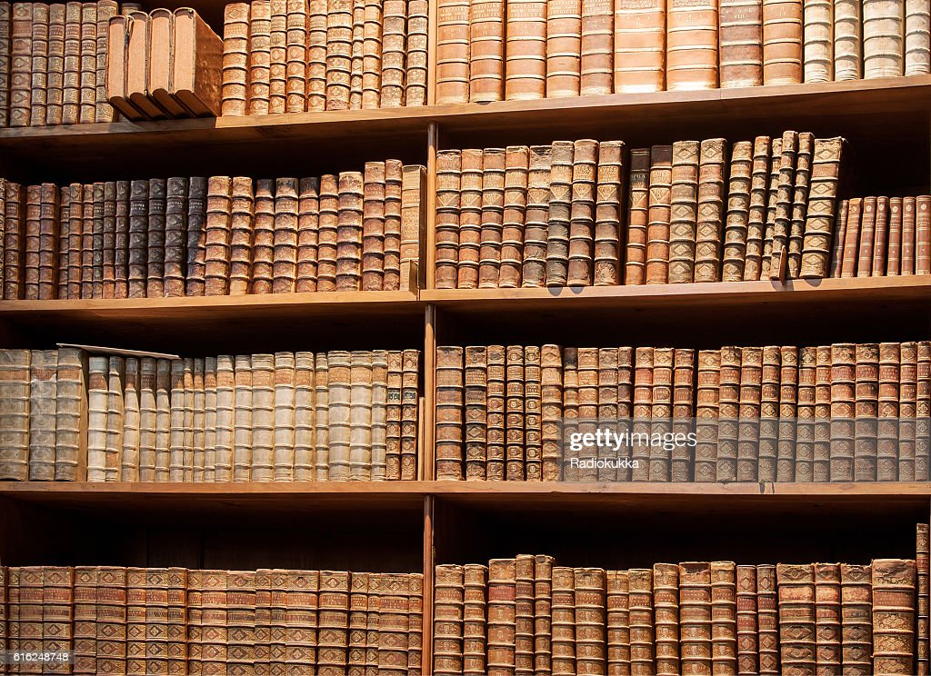 Vintage bookshelf with old books in the library of Vienna : Stock Photo