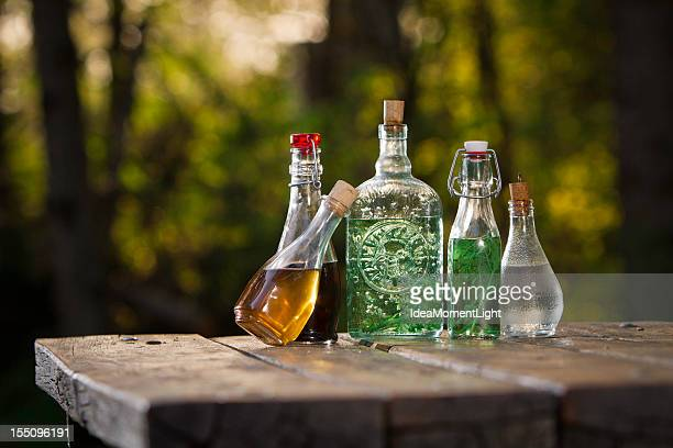 Vintage bottles with different herbal infusions