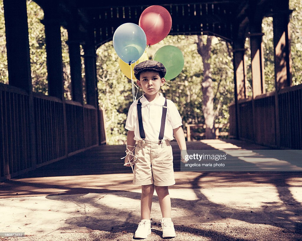 Vintage boy with birthday balloons
