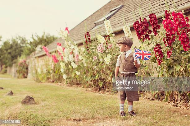 Vintage British Boy Standing With Union Jack