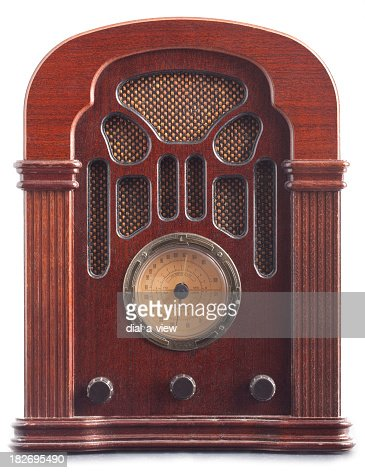 Vintage brown radio with dial and speakers built in