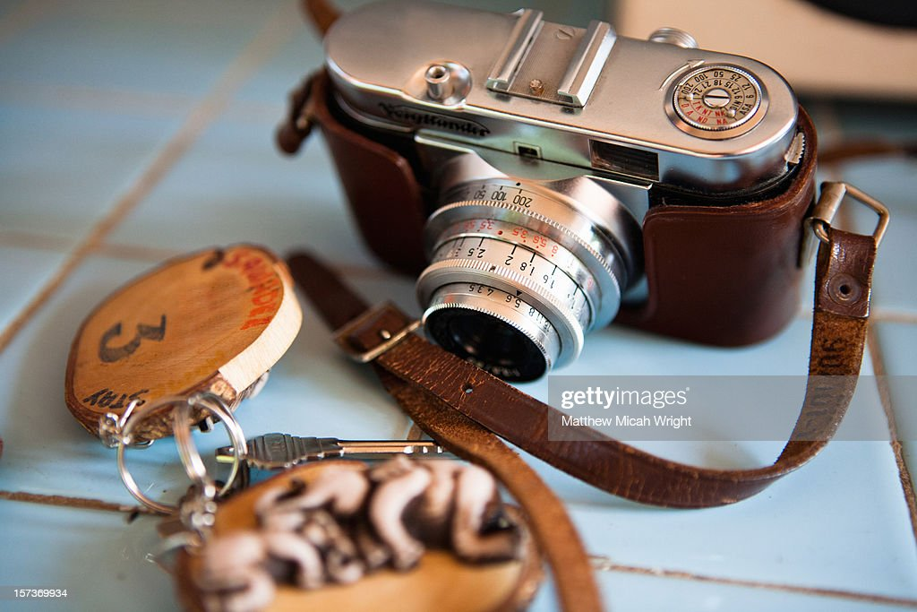 A vintage camera and Thai engravings on hotel key : Stock Photo