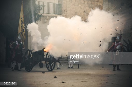 Vintage Canon Being Shot with Cloud of Smoke