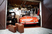 Vintage car and trunk suitcases in garage