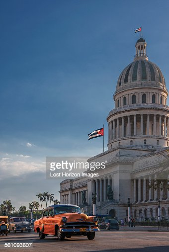 Vintage car driving in front of Capitol Building, Havana, Cuba