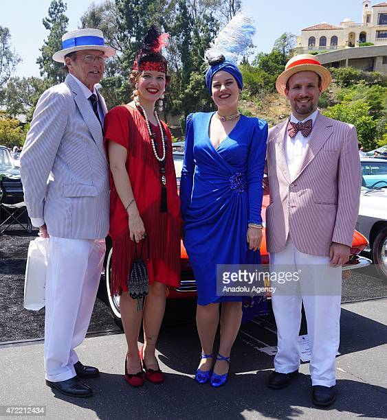 Vintage car enthusiasts pose during Concours d'Elegance 2015 at Greystone Mansion in Beverly Hills Los Angeles CA May 4 2015 Vintage cars of...