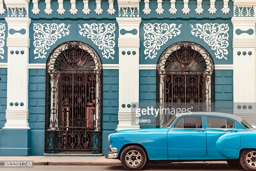 vintage car in front of colonial style house in Camagüey Cuba : Stock Photo