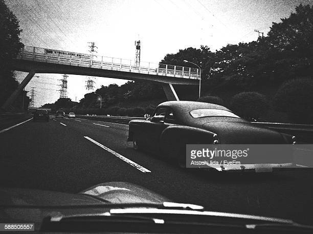 Vintage Car On Highway Seen From Windshield