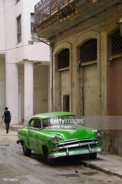 Vintage car parked in front of old building