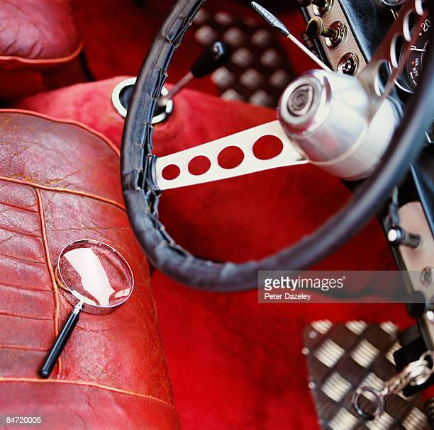 Vintage car with magnifying glass.