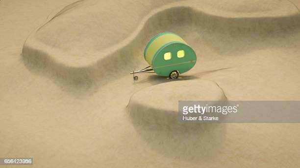 vintage caravan in dunes