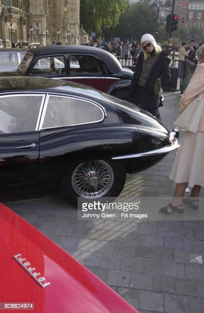 Vintage cars are parked in Old Palace Yard in front of the Houses of Parliament in central London Vintage carowners gathered as part of 'Destination...