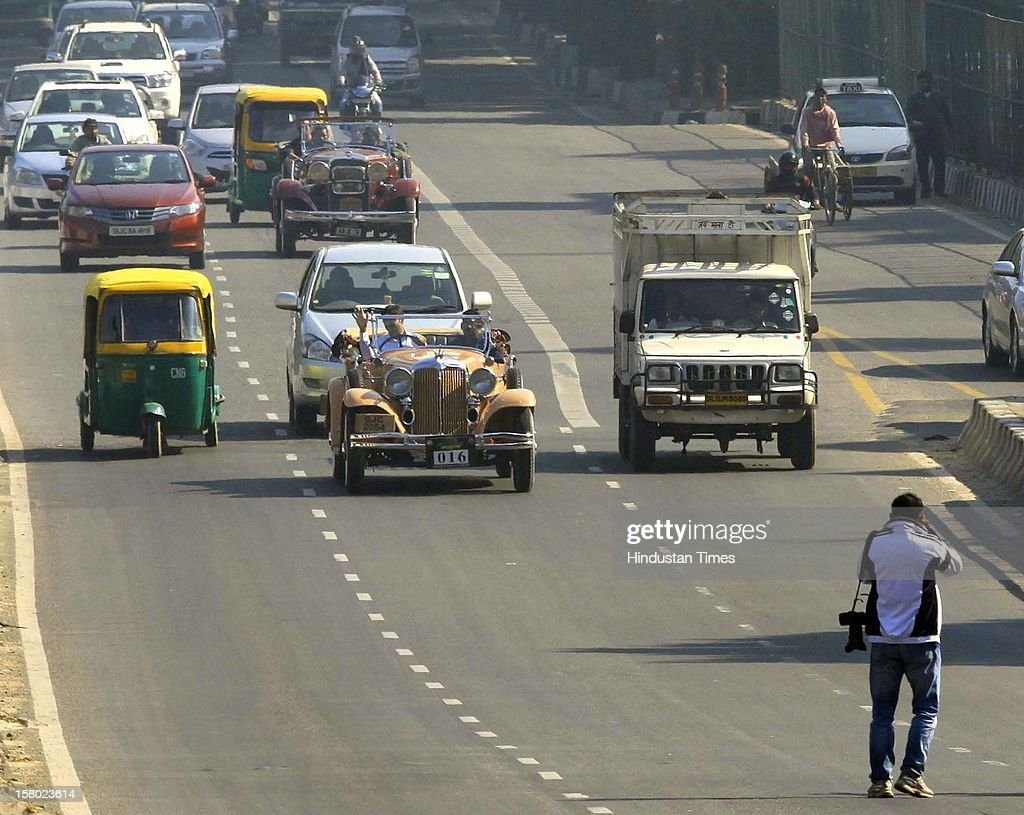 Vintage cars is driven out on Road at Panchsheel Park Flyover after '21 Gun Salute Vintage Rally' flags off on December 9, 2012 in New Delhi, India.