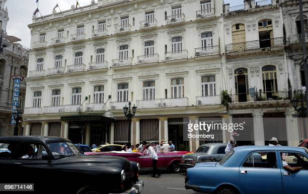 Vintage cars pass in front of the Inglaterra Hotel in Havana Cuba on Friday June 16 2017 US President Donald Trump announced new restrictions Friday...